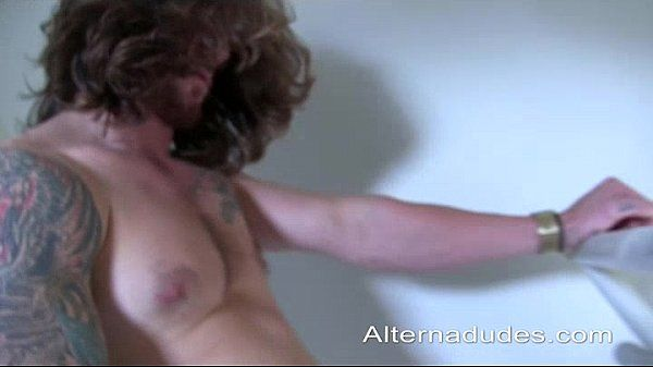 Tatted Muscle Ginger with Long Hair