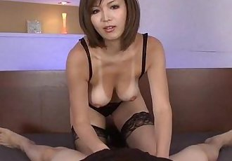 Sexy tanned Mai Kuroki in bed playing with a horny guys cock making him cum - 5 min