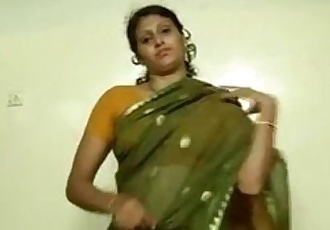 An indian mallu hot neighbour bhabhi teaching how to wear saree - 1 min 32 sec