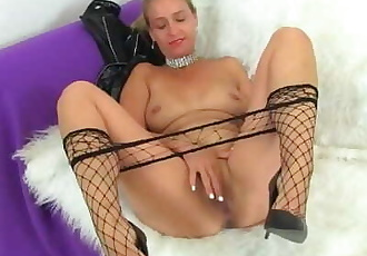 English milf Caz kicks her masturbation habits up a notch