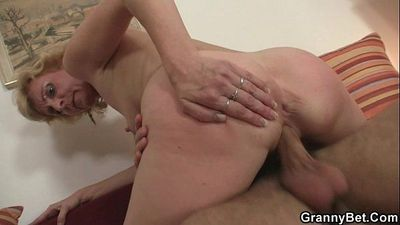 Blonde granny jumps on his young cock - 6 min