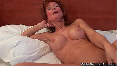 Sultry grandma probes her old pussy with a dildo - 5 min HD