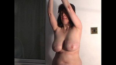 Mature tit whipping - 1 min 11 sec