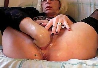 Slutty grandma in stockings fists her hairy cunt - 5 min HD