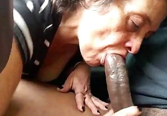 Mature lady sucks a black shaft - 2 min