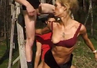 Skinny Milf Gets Fucked Outside By Two Guys