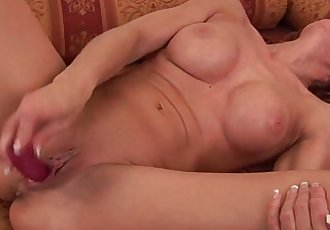 Sultry senior lady is toying her meaty pussy