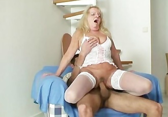 Blonde granny rides his big dick