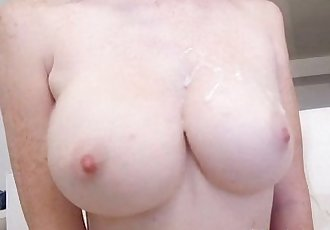 Busty redhead rides cock
