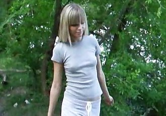 Gorgeous blonde model strips by the lake