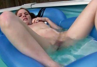 Megan Masturbates in the pool on inflatable pool toy