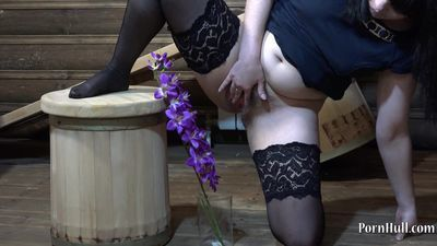Young brunette with hairy pussy, urinating on a flower