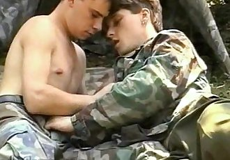 Military boys empting their meaty cannons outdoors