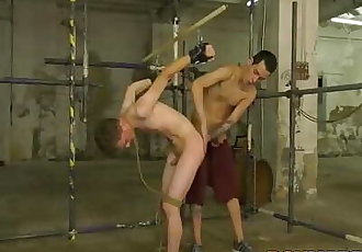 Young gay Johnny Polak roped up before anal penetration