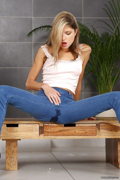 Skinny teen Gina Gerson spreading legs to pee in her jeans & finger twat