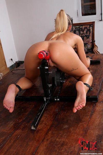 Chloe Lacourt is locked into bondage device for machine fuck and spanking