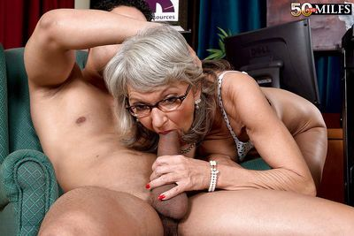 Older wife Cheyanne giving her husband oral sex while wearing glasses