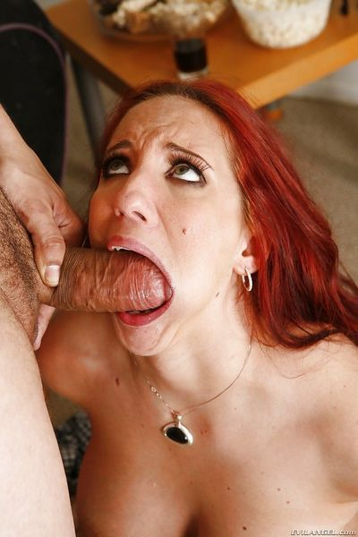 Redhead beauty Kelly Divine is trying to swallow this big dick