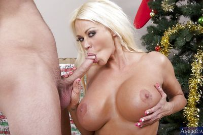 Curvy blonde cougar in stockings gets shagged under the Christmas tree - part 2