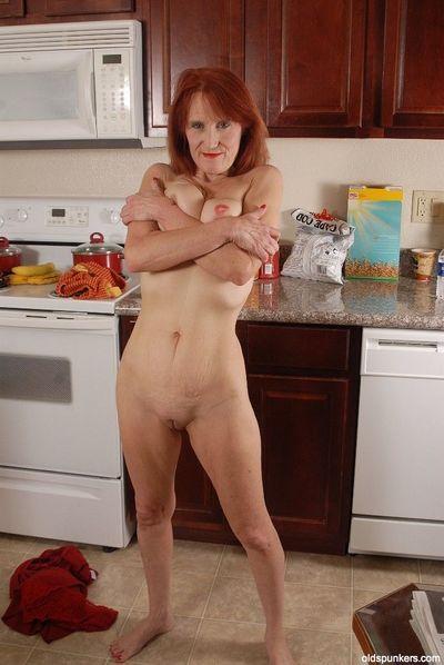 Redhead granny Debra is lying naked on the floor and masturbating - part 2