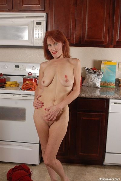 Redhead granny Debra is lying naked on the floor and masturbating - part 2