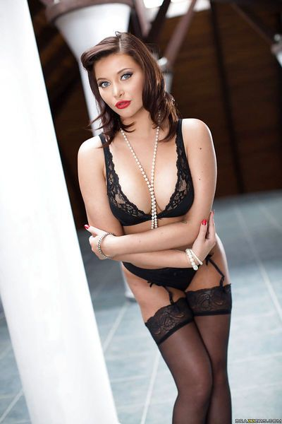 European model Anna Polina poses for softcore pantyhose and garter shoot