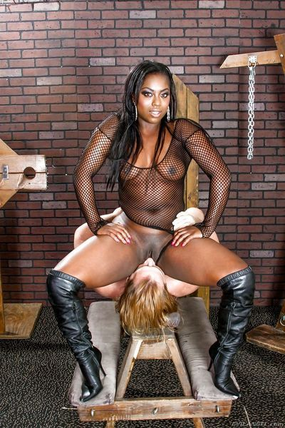 Black MILF Janea Jolie abusing male slave in mesh bodystocking & leather boots