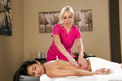 Sensuous blonde masseuse has a lesbian sex with her latina client