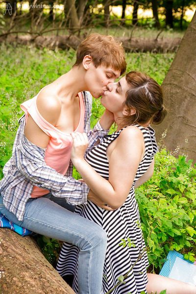 Short haired dykes Anahi and Nora go outdoors to finger each others pussy