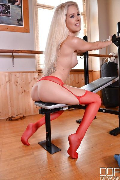 Thin cheerleader Monique Woods stripping down to red stockings on weight bench - part 2