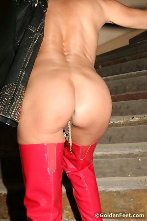 Sexy mature woman Lady Sarah flashing her pierced vagina outdoors