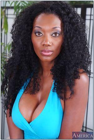 Black MILF Nyomi Banxxx revealing dark pussy and huge nipples outdoor