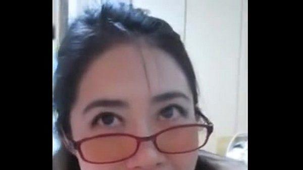 Geeky Asian girlfriend sucks a big dick and gets a facial