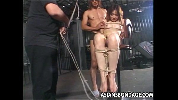 Asian hottie tied up to try a bdsm session