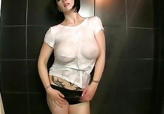 wet t-shirt slut shows off huge tits and perky nipples
