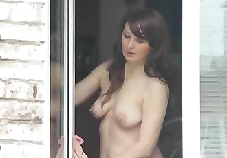 Naked Step mom washes window son spies on mommy. Naked in public. Spying