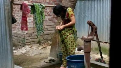 desi girl bathing outdoor for more visit http://sh.st/3b8dG - 2 min