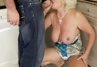 Amateur grandma is giving a footjob - 6 min