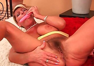 Big Titted Granny Is Toying Her Hairy Pussy And Fingering Her Ass