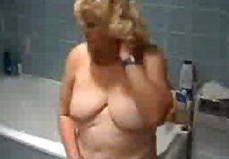 Granny teasing in the bathroom