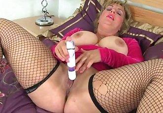 Busty milf Danielle fucks herself with a dildo